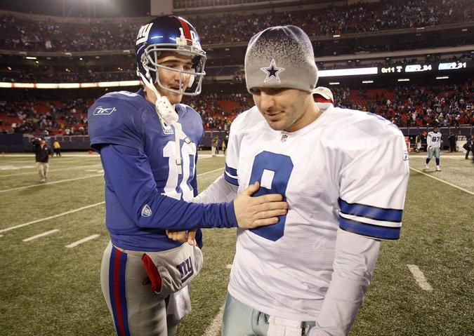 Cowboys quarterback Tony Romo (right) and Giants quarterback Eli Manning (10) meet on the field after the game.