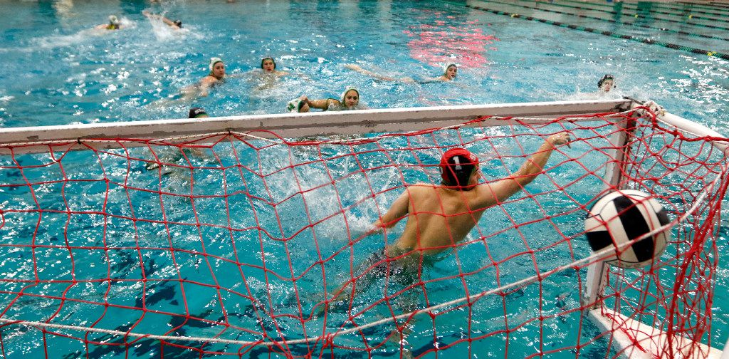 Nathan Winkler, Southlake Carroll water polo player tries to block the ball during practice at Carroll I.S.D. Aquatics Center on Wednesday, May 3, 2017 in Southlake, Texas. (David Woo/The Dallas Morning News)