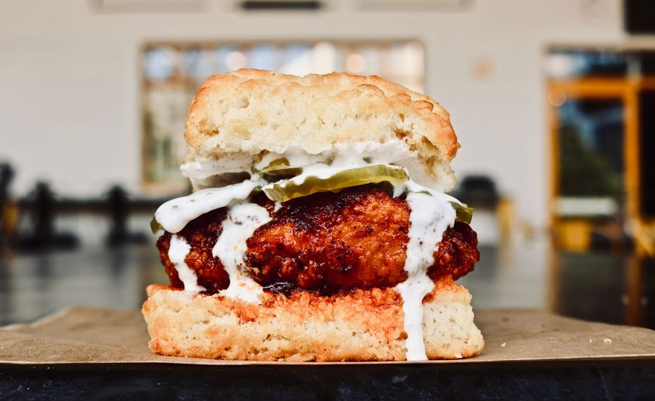 The Hot Hot Chicken at the Biscuit Bar is a Nashville-style hot chicken sandwich on a biscuit, with dill pickles and house-made ranch.