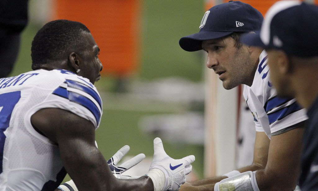 Dallas Cowboys wide receiver Dez Bryant (88) and Dallas Cowboys quarterback Tony Romo (9) talk on the sideline after yelling at each other in the second half of NFL football action at Ford Field in Detroit, MI on Sunday, October 27, 2013.  (Brad Loper/The Dallas Morning News)