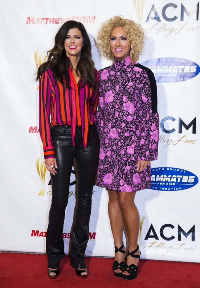Karen Fairchild, left, and Kimberly Schlapman of country music group Little Big Town pose for photos on the red carpet at the ACM Lifting Lives gala.