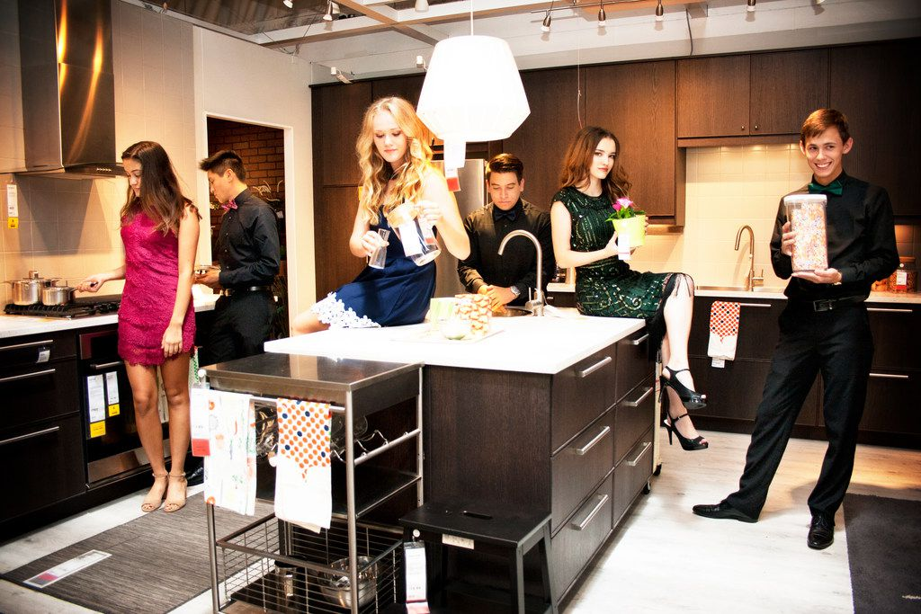 A cocktail party in someone's kitchen? Hardly: It's a photo shoot at Ikea in Frisco before these teenagers went to homecoming. That's (from left) Casey Ehrman, Zach Pajela, Adrienne Romney, Marco Cardona, Megan Goulding and Harrison McFarland. Where are the others? Probably lounging in the fake room nearby.