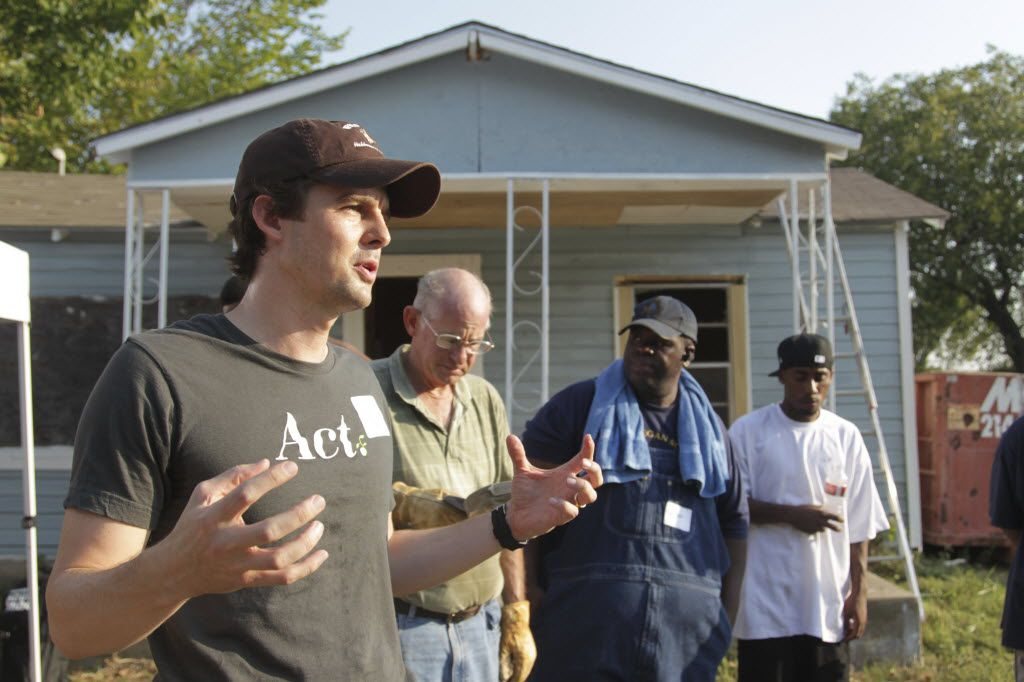 ACT founder and president Reid Porter talks to some of the volunteers at the  demolition of a dilapidated house in the 4000 block of Canada Drive in West Dallas. (2011 File Photo/Ron Baselice)