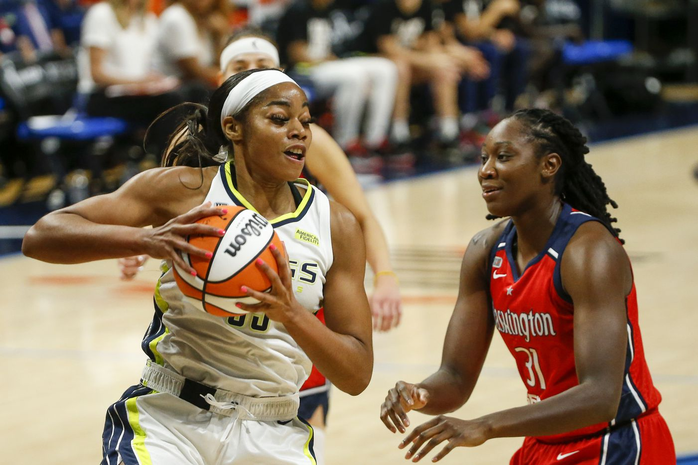 Dallas Wings forward/center Charli Collier (35) secures a rebound in front of Washington Mystics center Tina Charles (31) during the first quarter at College Park Center on Saturday, June 26, 2021, in Arlington. (Elias Valverde II/The Dallas Morning News)
