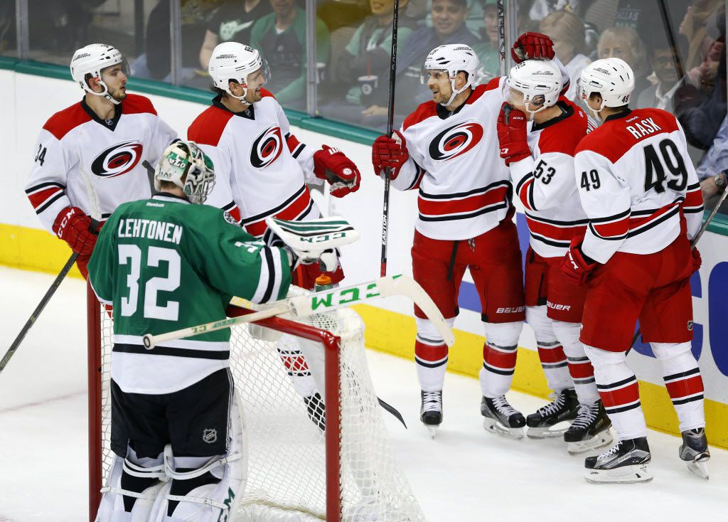 Carolina Hurricanes players congratulate left wing Jeff Skinner (53) on his game typing goal (5-5) on Dallas Stars goalie Kari Lehtonen (32) in the third period at the American Airlines Center in Dallas, Tuesday, December 8, 2015.  The Stars won through in the closing minute, 6-5. (Tom Fox/The Dallas Morning News)