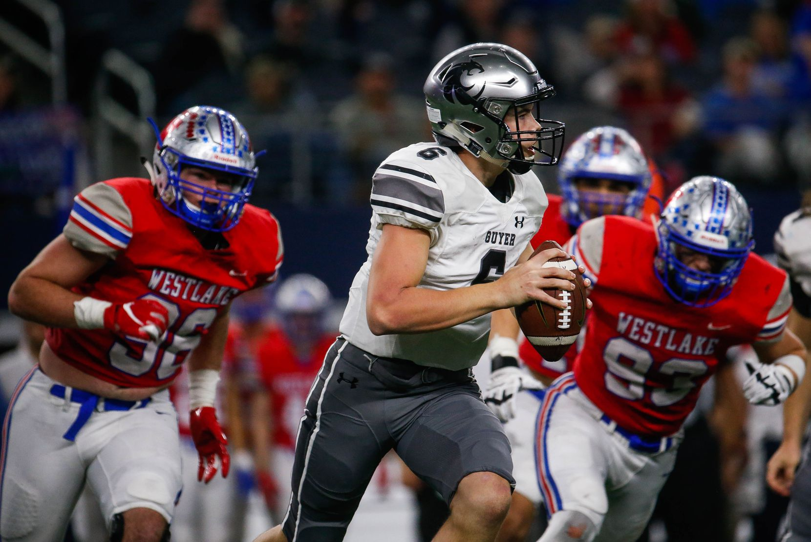 Denton Guyer's QB Jackson Arnold (6) is followed by Westlake's defense in the fourth quarter of a Class 6A Division II state championship game between Denton Guyer and Austin Westlake at the AT&T Stadium in Arlington, on Saturday, December 21, 2019. Westlake won the game 24-0.