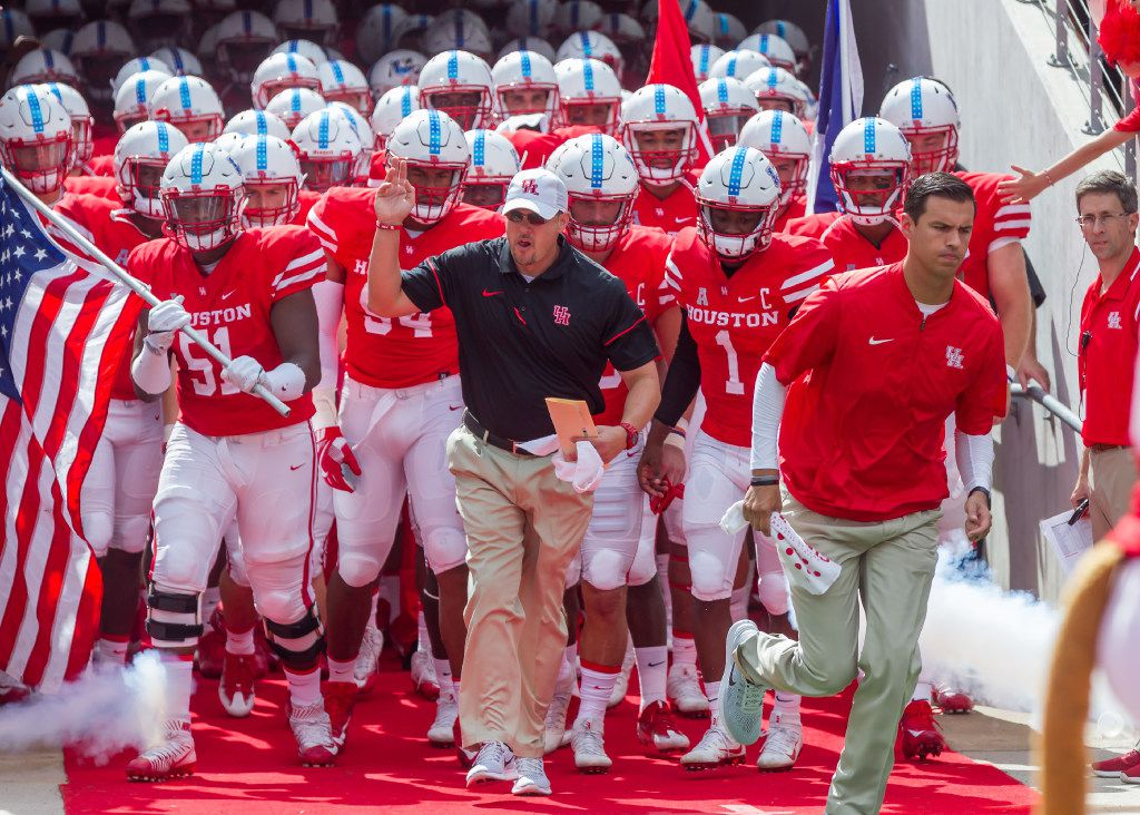 FILE - 10 September, 2016: Houston Cougars head coach Tom Herman leads the team onto the field during the NCAA football game between the Lamar Cardinals and Houston Cougars at TDECU Stadium in Houston, Texas. (Photograph by Leslie Plaza Johnson/Icon Sportswire) (Icon Sportswire via AP Images)
