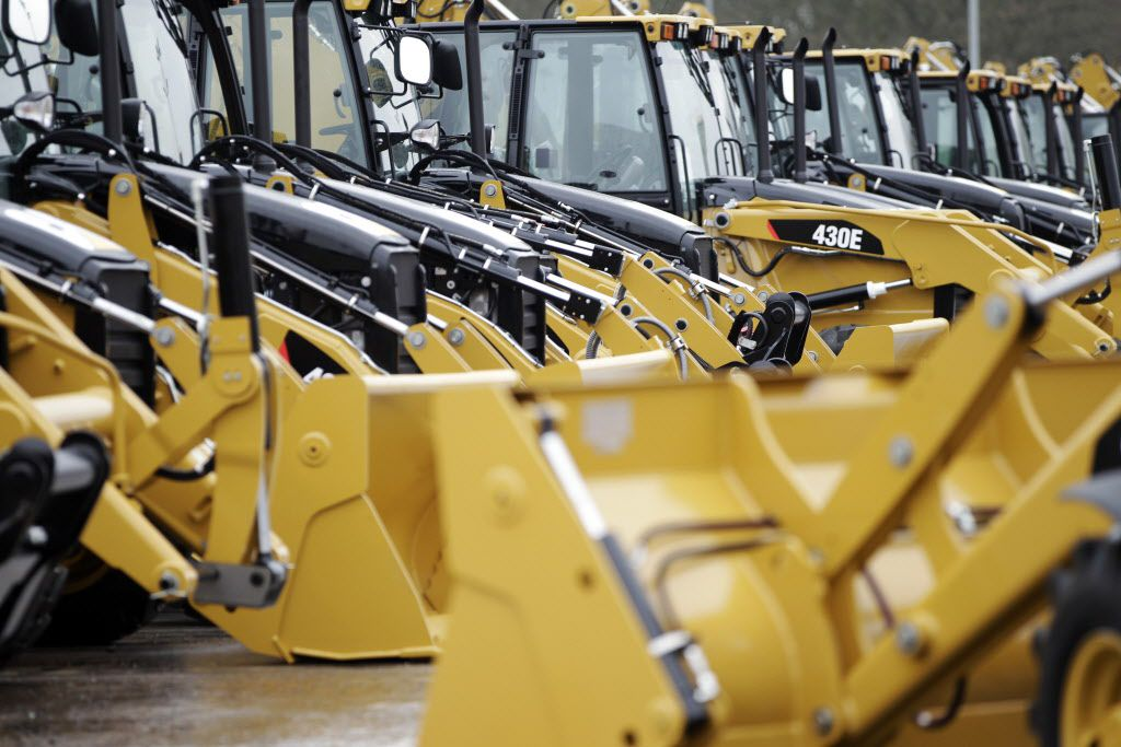 Newly manufactured Caterpillar Inc. 'backhoe' diggers are parked ready distribution at the factory headquarters in Desford, U.K. A woman was crushed to death Monday when a backhoe operator dropped the bucket on her at a San Antonio construction site.