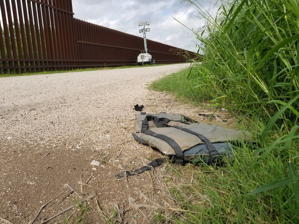 A discarded life jacket lays on the levee road and border wall in Hidalgo, Texas, on Sunday Oct. 14, 2018, less than a mile from the Rio Grande.