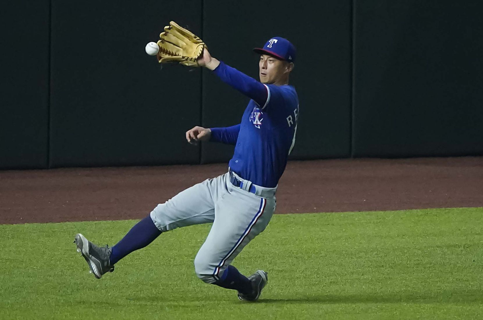 Outfielder Rob Refsnyder chases down a double off the bat of Scott Heineman in an intrasquad game during Texas Rangers Summer Camp at Globe Life Field on Thursday, July 16, 2020.