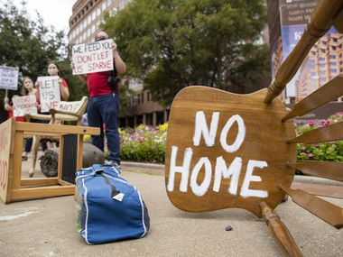Protestors place furniture and rally outside of the office of Senator John Cornyn on Sept. 1, 2020 in Dallas.
