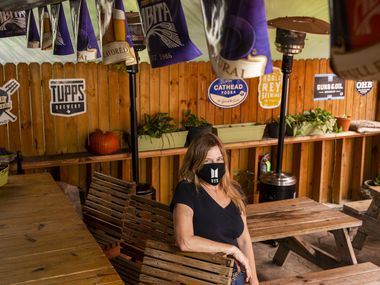 Owner Meri Dahlke poses for a portrait at Ten Bells Tavern in the Bishop Arts District of Dallas on Thursday, May 21, 2020.