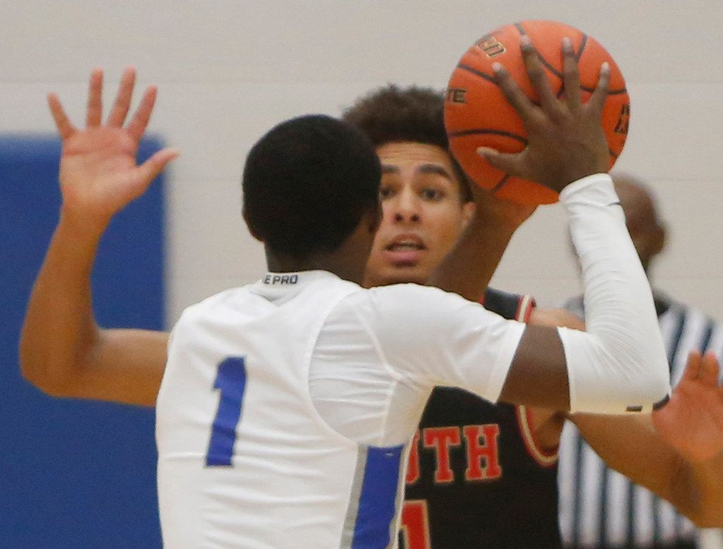 South Grand Prairie's Anthony Solomon (1) defends Grand Prairie's Jaylin Posey (1) during first half action. The two teams played their boys basketball game at  Grand Prairie High School in Grand Prairie on January 11, 2020. (Steve Hamm/ Special Contributor)