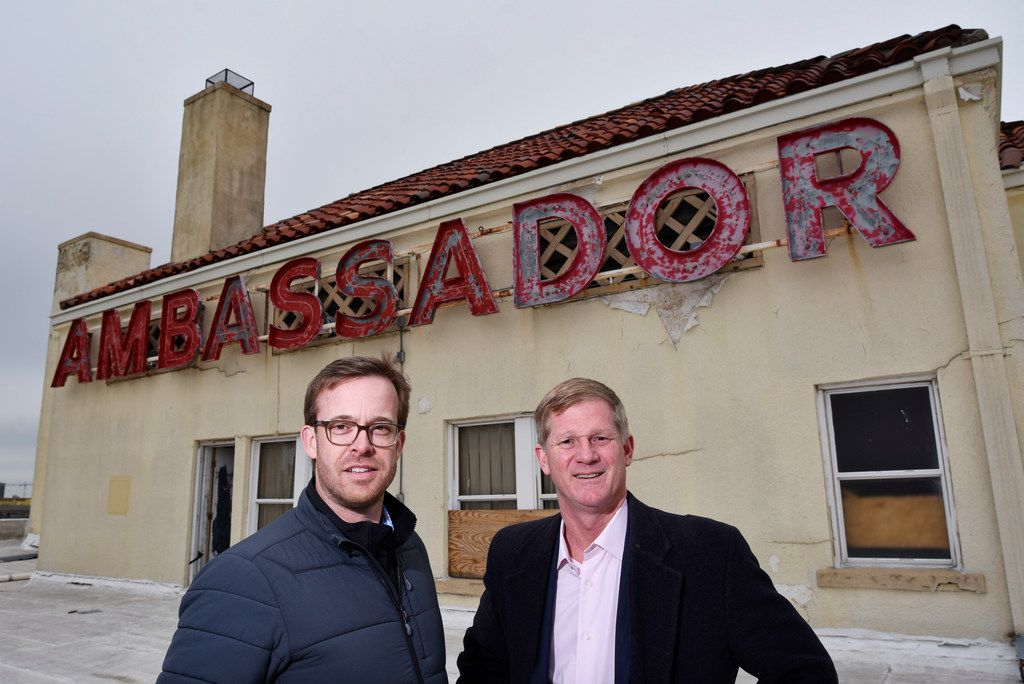 Project and asset manager Steve Owen Jr. (left) and Jim Lake Jr. stand on the roof of the historic Ambassador Hotel during a tour of the site in the Cedars neighborhood.
