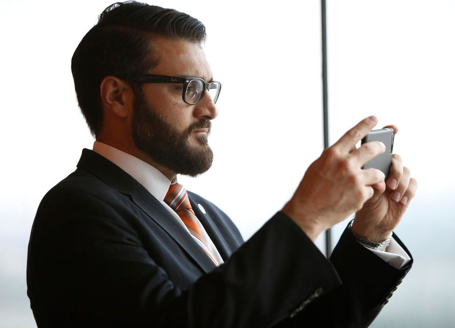 Hamdullah Mohib, Ambassador to Argentina representing the United States, pauses to photograph a portion of Las Colinas  from the La Cima Club as guests and honorees gather and mingle prior to dinner and the awards presentations to women from Afghanistan and Rwanda that have completed studies in entrepreneurial skills. Graduation ceremonies for attendees of the Peace Through Business entrepreneurial boot camp was held at the La Cima Club in Irving on July 27.  (Steve Hamm/ Special Contributor)