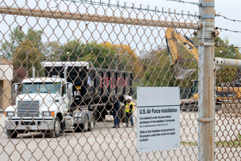 Workers prepare a truck to remove debris from the former Texas Air National Guard armory as it is demolished Nov. 7 at Central Park in Garland.  The former armory was razed to make room for a new dog and skate park.