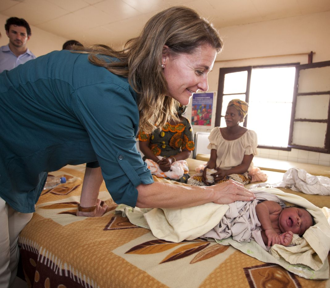 Melinda Gates, co-chair, and trustee, Bill & Melinda Gates Foundation, visits a baby in the Marie Stopes International outreach program at Wakhinane health post, Dakar, Senegal on July 9, 2012.