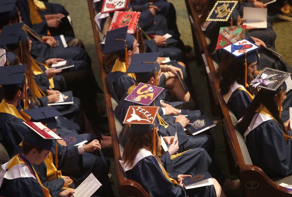 It's common for graduating seniors to decorate their caps with the logo of the college they plan to attend.