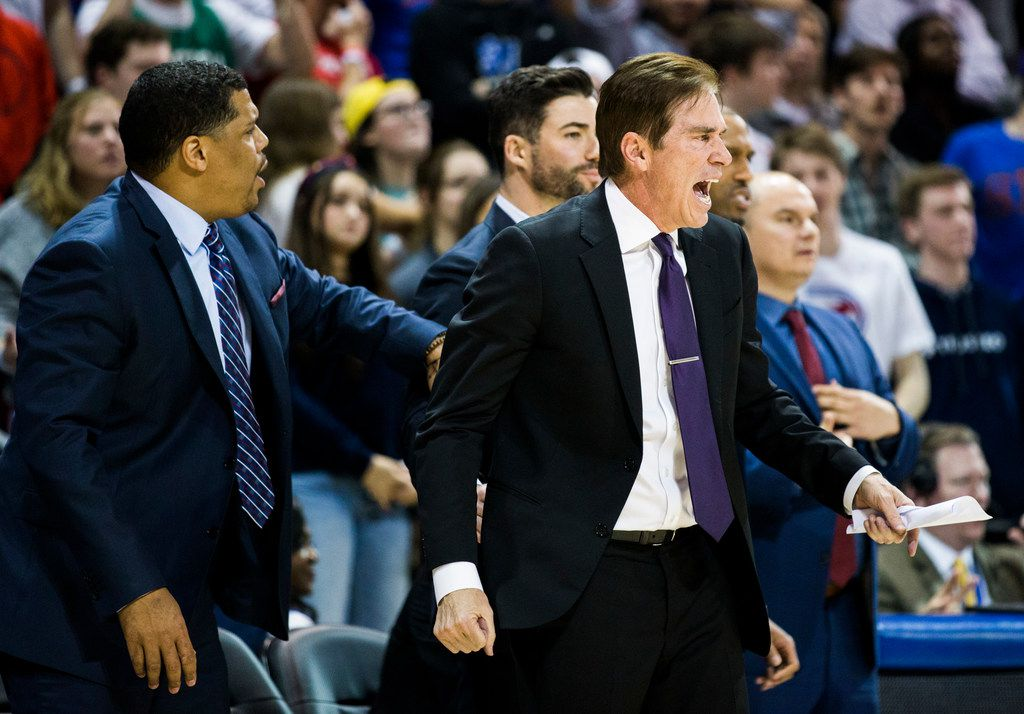 Southern Methodist Mustangs head coach Tim Jankovich (right) yells from the sideline during the second half of a basketball game between SMU and University of Houston on Saturday, February 15, 2020 at Moody Coliseum in Dallas. (Ashley Landis/The Dallas Morning News)