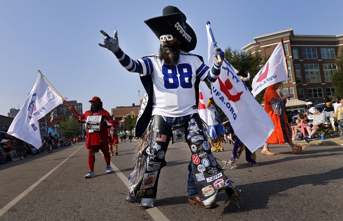Dallas Cowboys fan Shane Wentz of Grove City, Pennsylvania marches with other NFL mascots in the Canton Repository Grand Parade in downtown Canton, Ohio, Saturday, August 7, 2021. The Pro Football Hall of Fame parade honored newly elected and former members of the Hall, including newcomers and former Dallas Cowboys players Cliff Harris, Drew Pearson and head coach Jimmy Johnson. (Tom Fox/The Dallas Morning News)