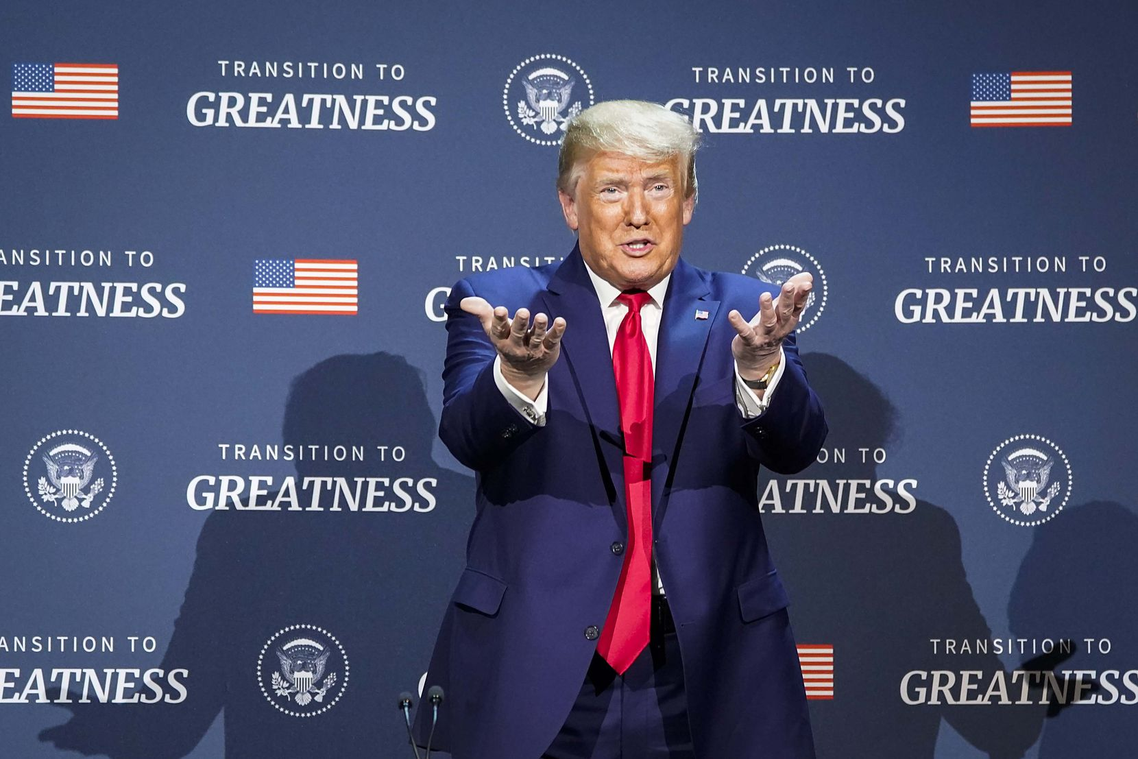 President Donald Trump motions to the audience as he participates in a roundtable conversation about race relations and policing at Gateway Church Dallas Campus on June 11, 2020, in Dallas.