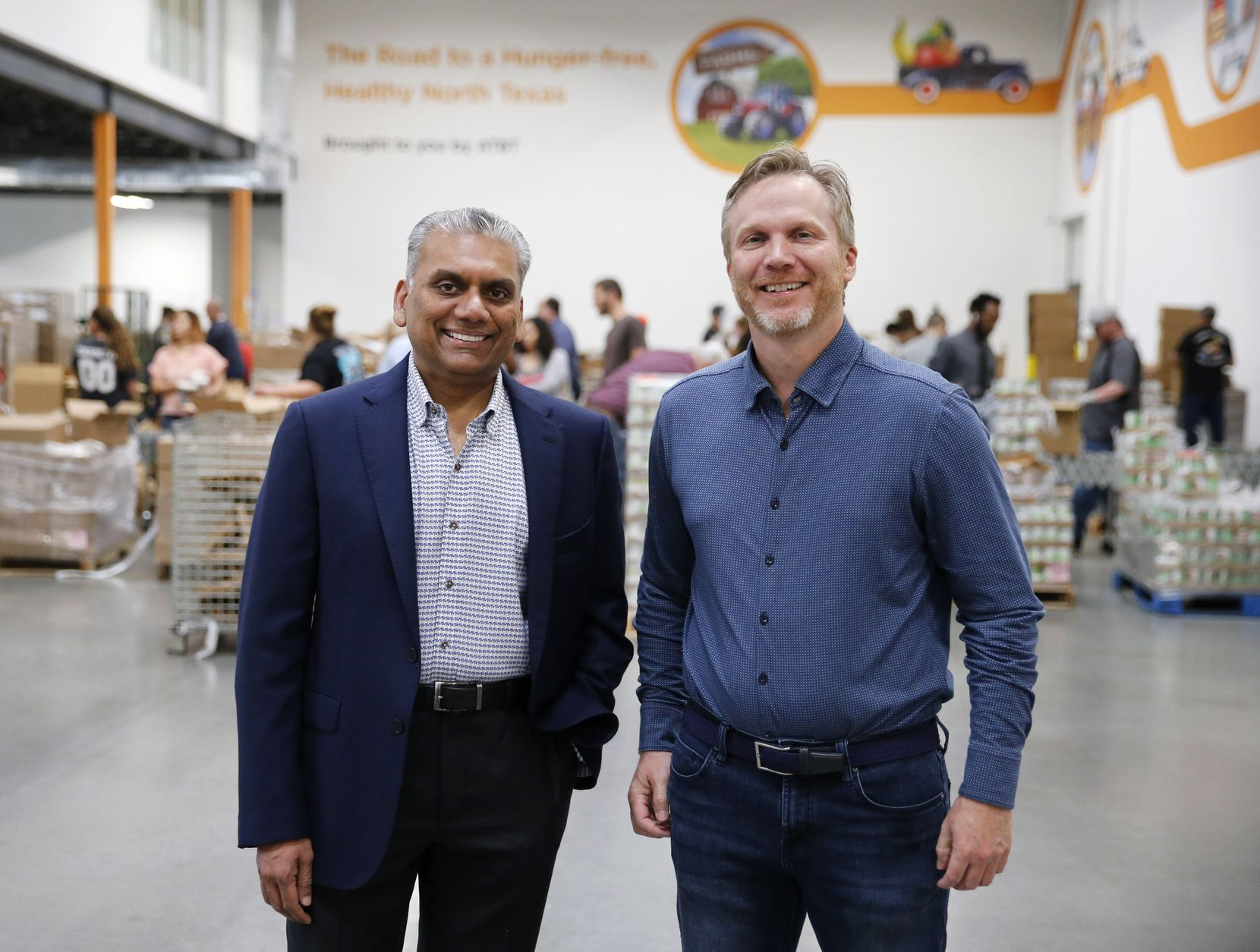 Anurag Jain, chairman of the North Texas Food Bank, posed with Shiftsmart president Patrick Brandt at the North Texas Food Bank in Plano in March.