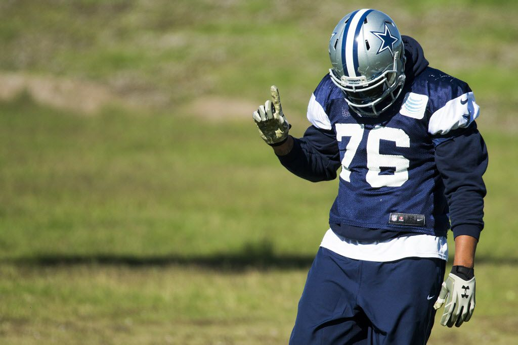 Dallas Cowboys defensive end Greg Hardy waves a finger as he dances to music while stretching before practice at the team's facility at Valley Ranch on Thursday, Nov. 19, 2015, in Irving. (Smiley N. Pool/The Dallas Morning News)