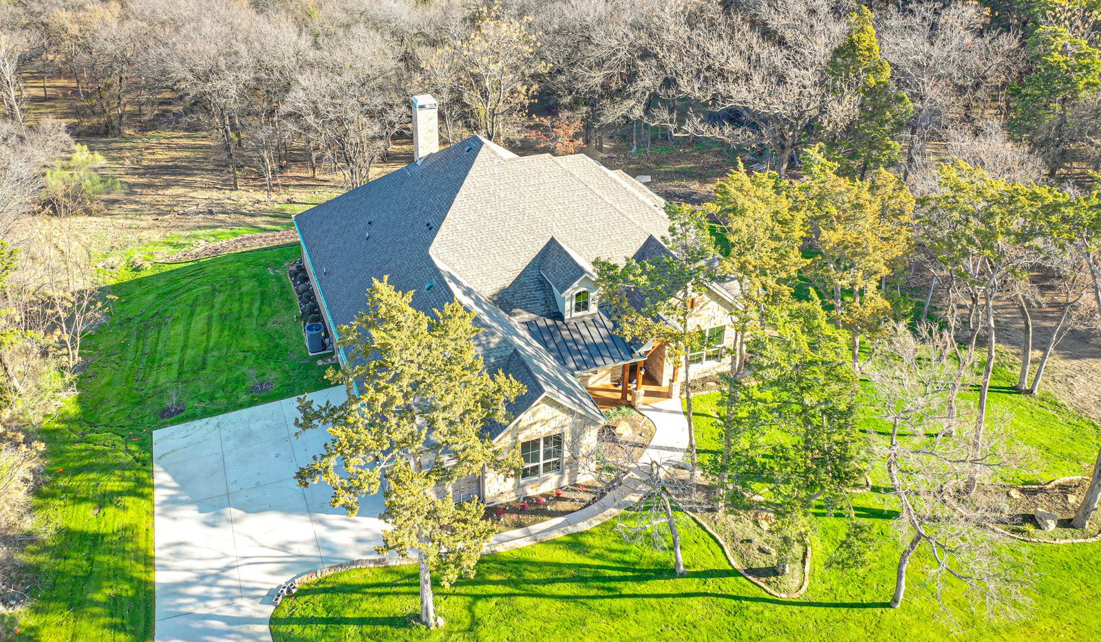 The traditional farmhouse design at 2427 Hardwick is situated on over 1 wooded acre in the Summit of Lake Ridge.