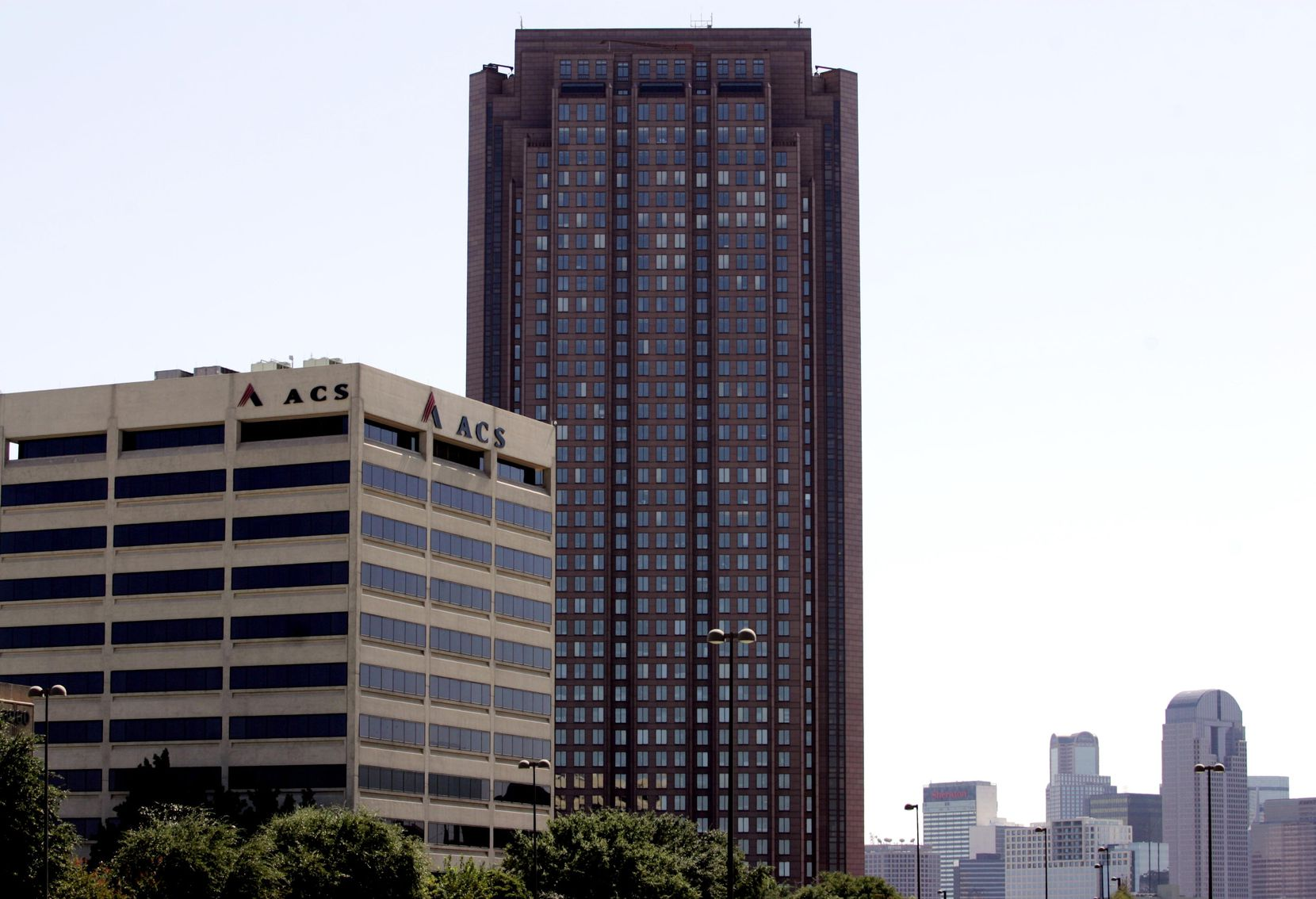 The former Affiliated Computer Services building is shown in front of the CityPlace tower.