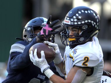Highland Park receiver Will Pettijohn (2) pulls in a touchdown pass over the defense of Frisco Lone Star defensive back Noah Bolton (21) during first quarter action. The two teams played their Class 5A Division l Region ll semifinal football playoff game held at Globe Life Park in Arlington on December 24, 2020.