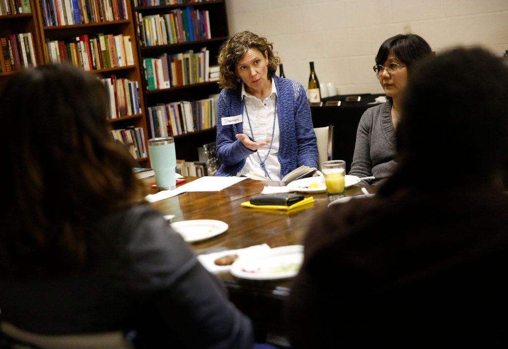 """Shannon Cerise leads a discussion about the book """"Little Fires Everywhere"""" by Celeste Ng during the Multicultural Women's Book Club meeting at the Dallas Institute of Humanities and Culture in Dallas on Tuesday night, Nov. 27, 2018. (Rose Baca/The Dallas Morning News)"""