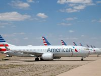 Eight of about a dozen grounded American Airlines Boeing 737 Max 8 aircraft are parked on a remote taxiway at Roswell International Air Center in Roswell, New Mexico, Wednesday, September 4, 2019.