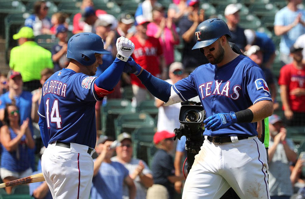 ARLINGTON, TEXAS - JUNE 01: Asdrubal Cabrera #14 fist bumps Joey Gallo #13 of the Texas Rangers after Gallo's two-run home run int he fourth ining against the Kansas City Royals at Globe Life Park in Arlington on June 01, 2019 in Arlington, Texas. (Photo by Richard Rodriguez/Getty Images)