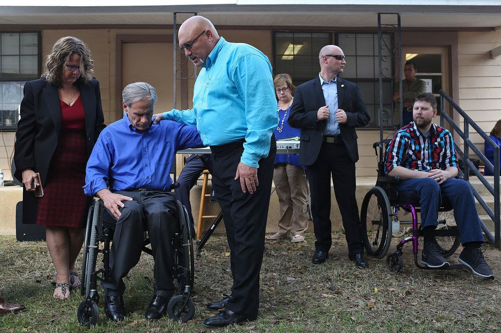 Pastor Frank Pomeroy and his wife, Sherri, prayed with Gov. Greg Abbott during Remembering Sutherland Springs: One Year Later at First Baptist Church of Sutherland Springs on Sunday. At right is shooting survivor Kris Workman.