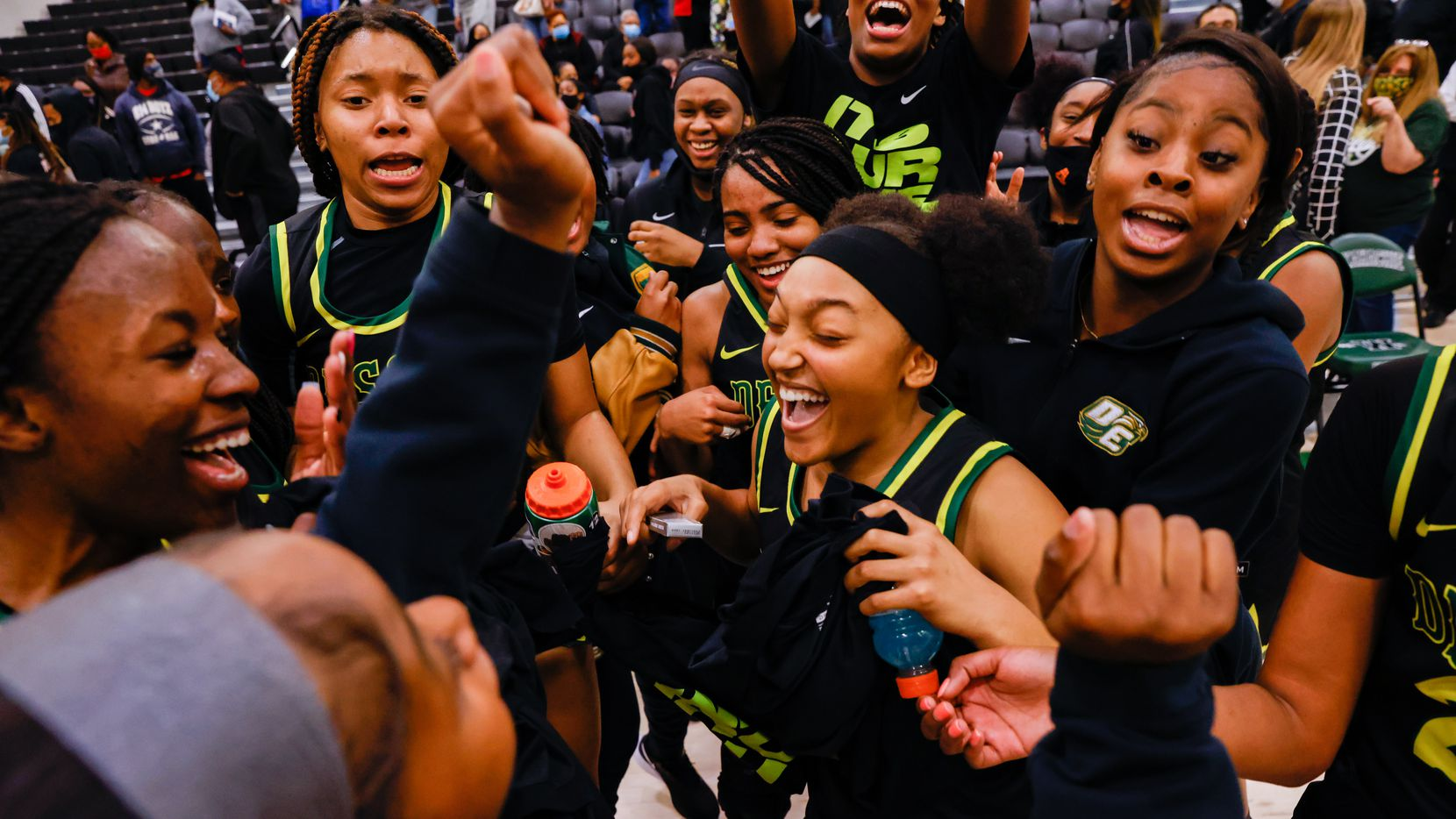 DeSoto celebrates their win against Duncanville following a girls basketball Class 6A Region II UIL game in Waxahachie on Tuesday, March 2, 2021. DeSoto won 52-39.  (Juan Figueroa/ The Dallas Morning News)