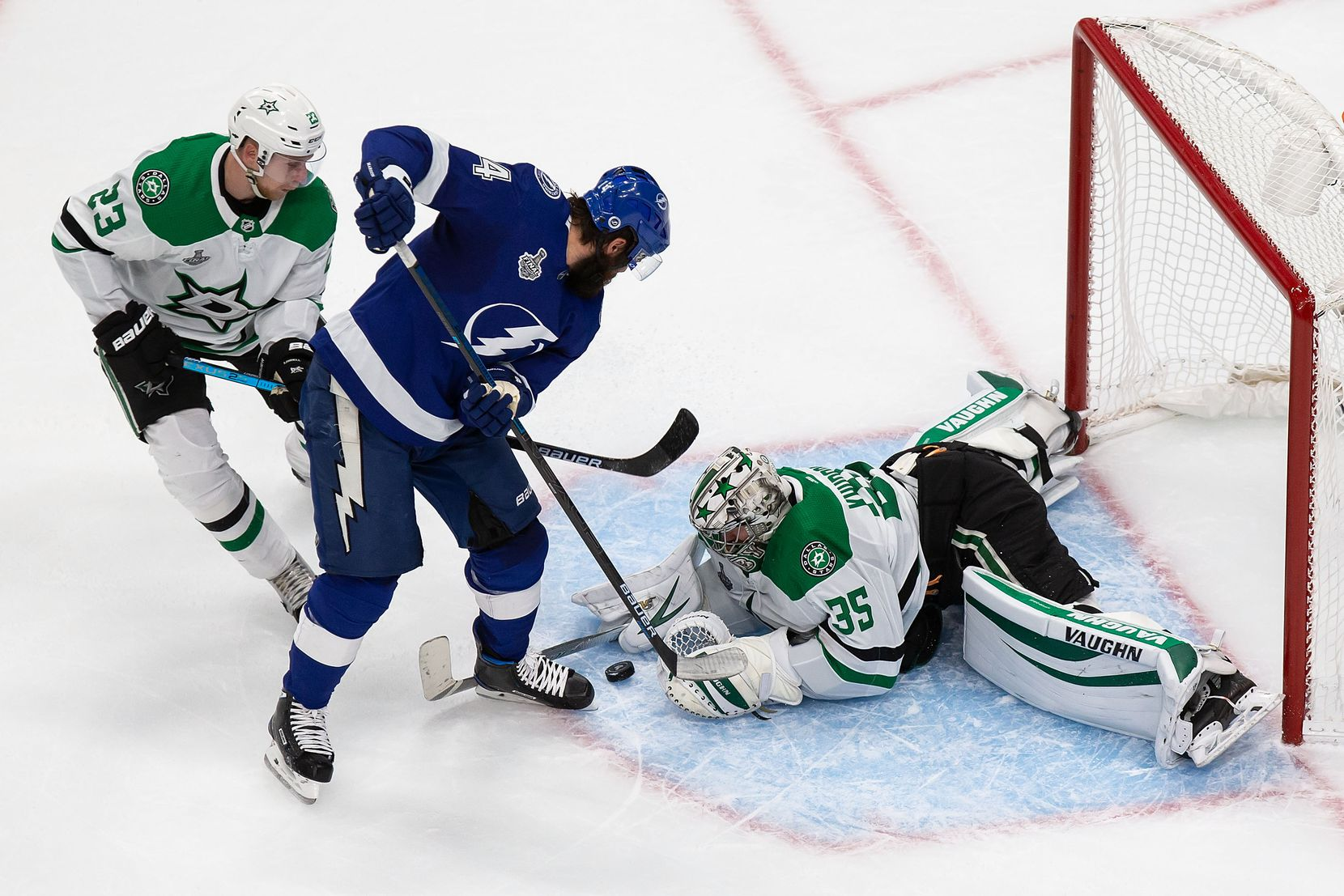 Esa Lindell (23) and goaltender Anton Khudobin (35) of the Dallas Stars defend against Pat Maroon (14) of the Tampa Bay Lightning during Game Two of the Stanley Cup Final at Rogers Place in Edmonton, Alberta, Canada on Monday, September 21, 2020. (Codie McLachlan/Special Contributor)
