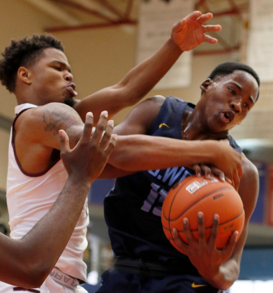 Mansfield Timberview senior Ahmad Richardson (11), left, battles with Putnam City West, Okla. guard Elijah James (15) for a rebound during first quarter action. The two teams competed as part of the annual Thanksgiving Hoopfest basketball tournament held at the Sandra Meadows Arena on the campus of Duncanville High School in Duncanville on November 29, 2019. (Steve Hamm/ Special Contributor)