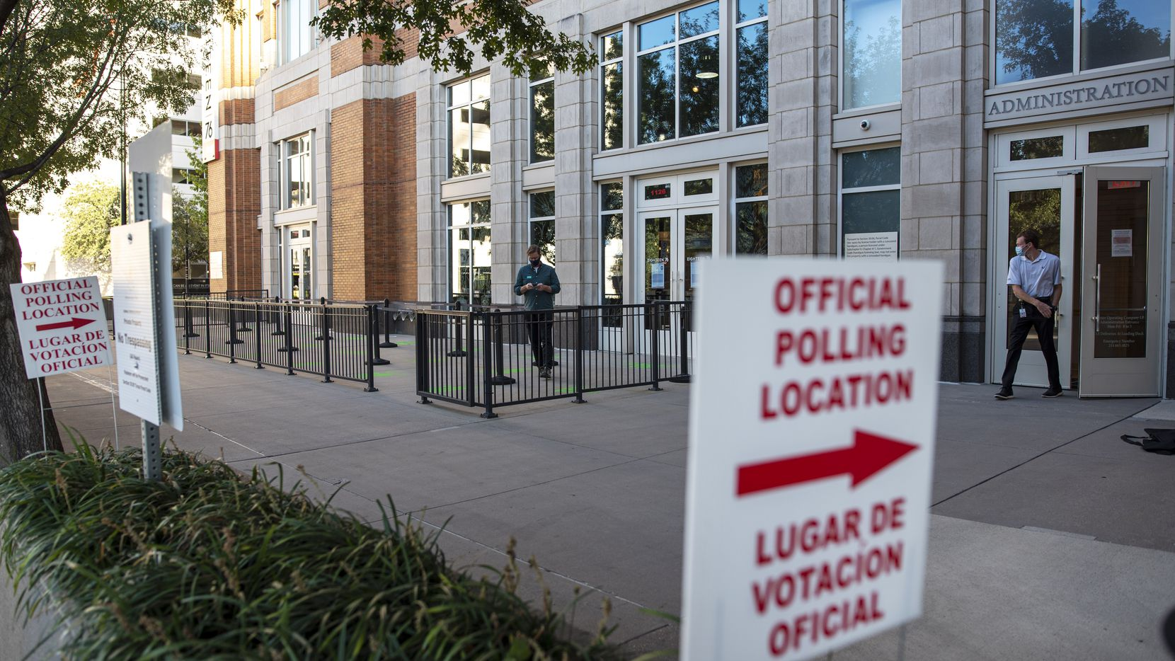 Official polling location signs located outside of the Dallas County Elections voting center inside the American Airlines Center in Dallas, on Monday, Oct. 12, 2020.