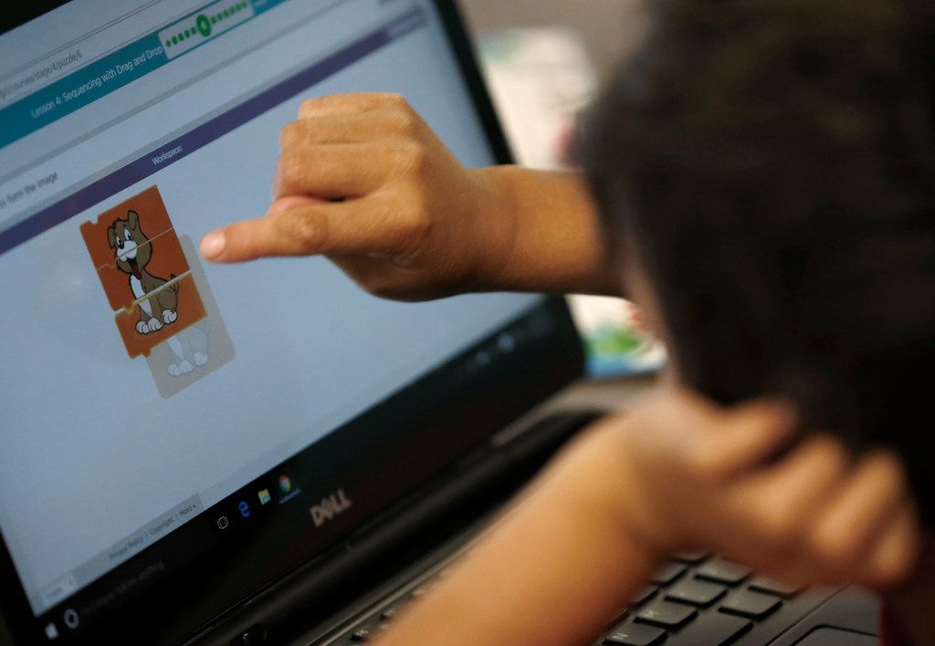 Kindergarten student Jayden Garcia works on a sequencing drag and drop lesson during a coding class at Frederick Douglass Elementary in Dallas, Thursday, Oct. 12, 2017. Dallas ISD is rapidly expanding computer science instruction to elementary schools across the district, as part of an effort between DISD and Code.org. (Jae S. Lee/The Dallas Morning News)