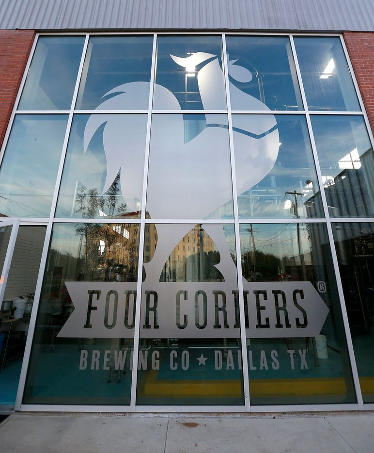 A Four Corners Brewing Co. sign is seen on the windows at the its new facility in the Cedars neighborhood in Dallas, Wednesday, Oct. 18, 2017.