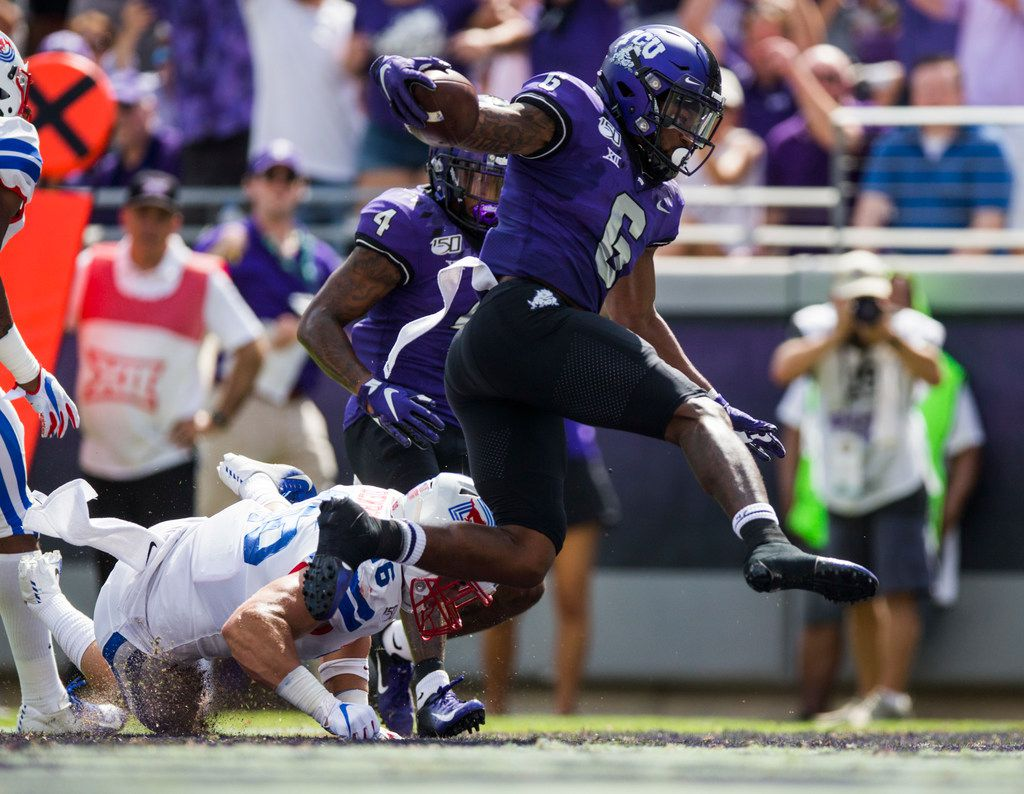 TCU Horned Frogs running back Darius Anderson (6) leaps across the goal line for a touchdown during the first quarter of a college football game between SMU and TCU on Saturday, September 21, 2019 at Amon G. Carter Stadium in Fort Worth.