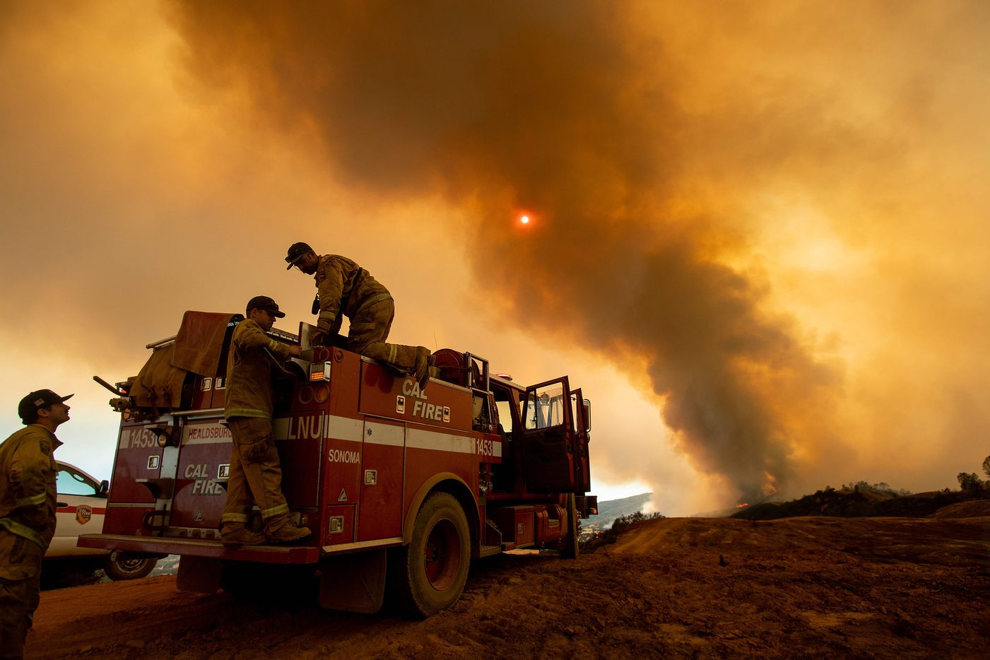 Firefighter Joe Smith retrieves supplies while battling the Ranch Fire, part of the Mendocino Complex Fire, burning along High Valley Rd near Clearlake Oaks, California, on August 5, 2018. Several thousand people have been evacuated as various fires swept across the state, although some have been given permission in recent days to return to their homes. / AFP PHOTO / NOAH BERGERNOAH BERGER/AFP/Getty Images