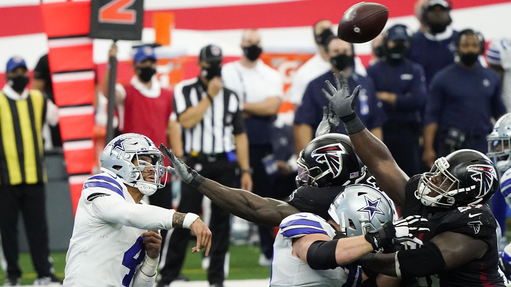 FILE - Cowboys quarterback Dak Prescott completes a 24-yard pass to wide receiver CeeDee Lamb to set up a game-winning field goal during the fourth quarter of 40-39 win against the Falcons on Sunday, Sept. 20, 2020, at AT&T Stadium in Arlington.