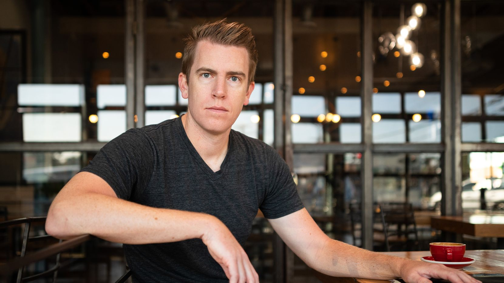 Author David McCloskey, 35, finished his first novel earlier this year titled, Damascus Station, he's shown at a coffee house in Dallas, on Monday, Sept. 20, 2021.