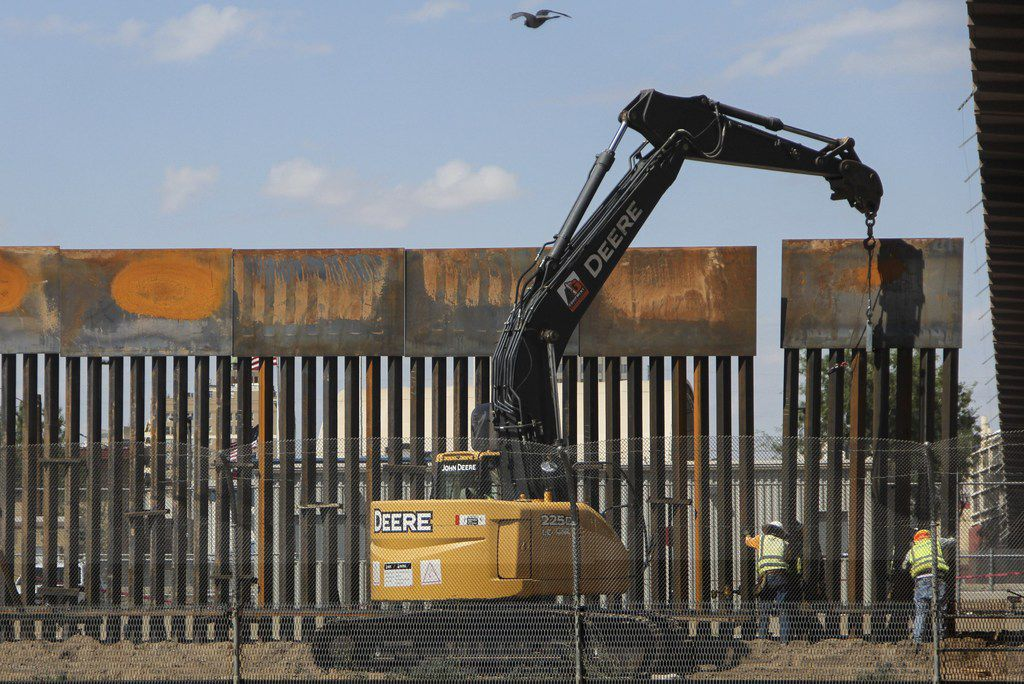 "Workers in El Paso replace a section of the border fence next to the international border bridge ""Paso del Norte"" as seen from Ciudad Juarez, in Chihuahua state, Mexico, on Sept. 26, 2018."