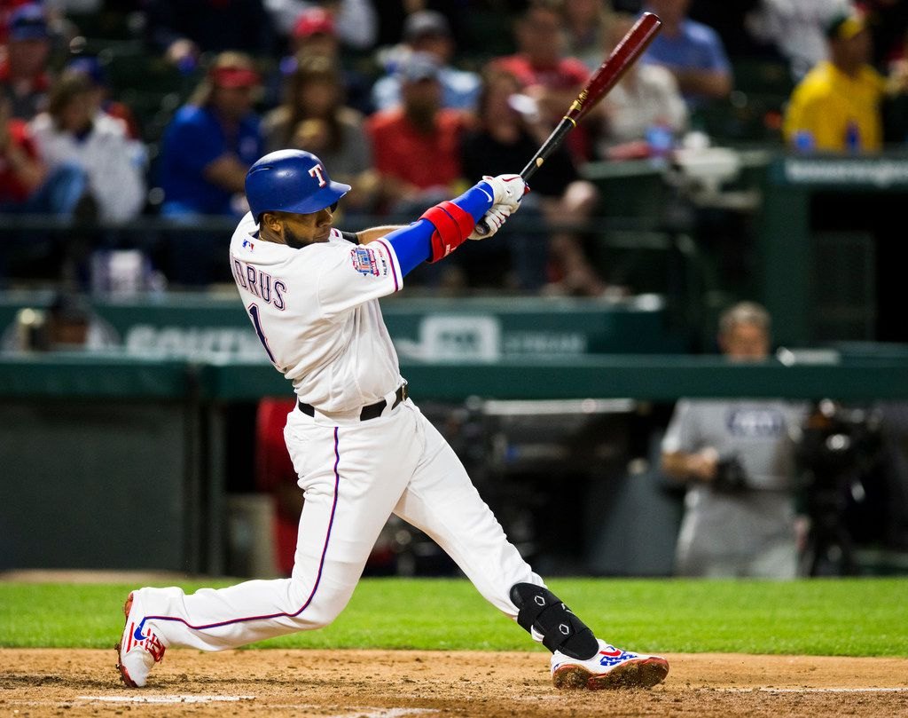Texas Rangers shortstop Elvis Andrus (1) hits a home run during the fifth inning of an MLB game between the Texas Rangers and the Oakland Athletics on Friday, April 12, 2019 at Globe Life Park in Arlington, Texas. (Ashley Landis/The Dallas Morning News)