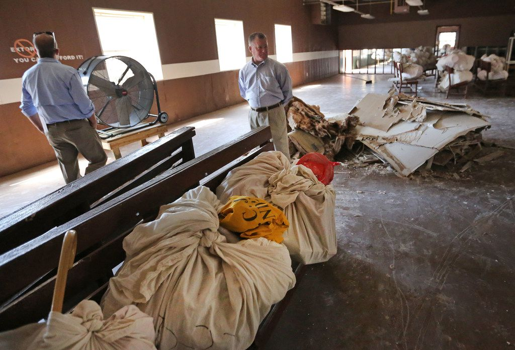 FOR BRANDI SWICEGOOD STORY TDCJ Executive Director Bryan Collier, center, surveys the cleanup progress in a multi-use building at the Terrell Unit after Hurricane Harvey flooded the building at the Texas Department of Corrections W.F. Ramsey Unit in Rosharon,Texas, photographed on Tuesday, September 12, 2017. (Louis DeLuca/The Dallas Morning News)