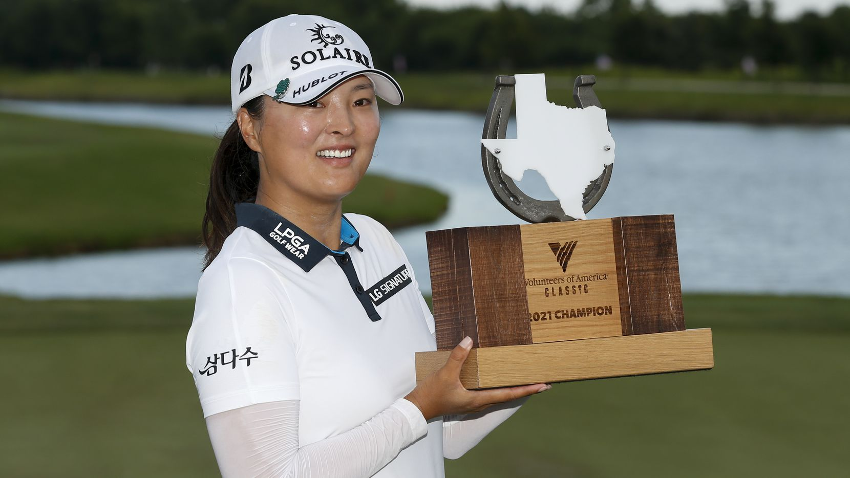 Professional golfer Jin Young Ko lifts the winner's trophy after winning the LPGA VOA Classic on Sunday, July 4, 2021, in The Colony, Texas. Ko finished the tournament 16 under par and one shot ahead of Matilda Castren.