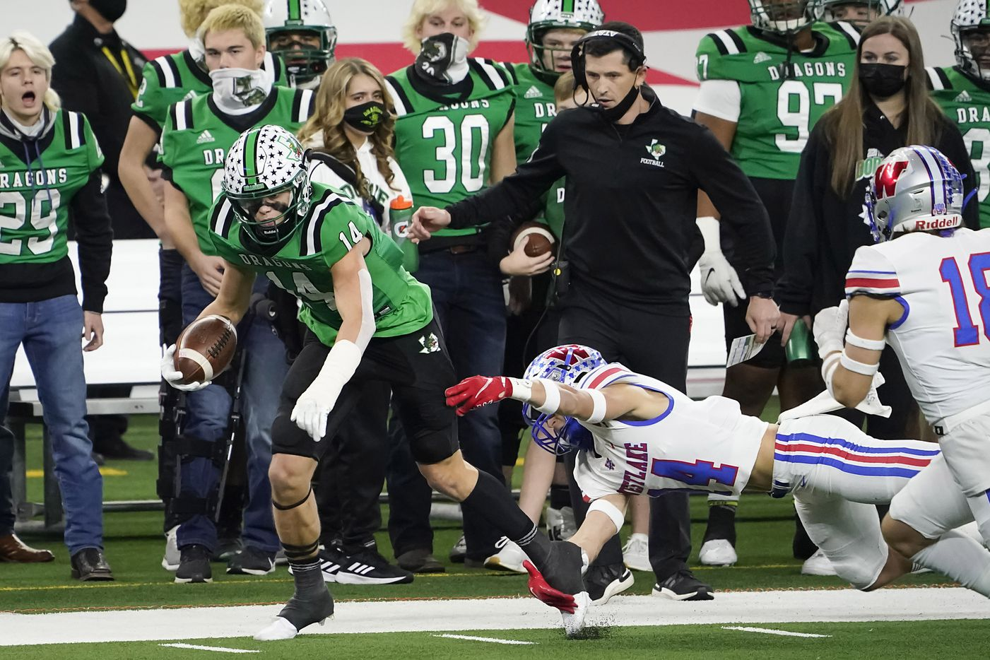 Southlake Carroll wide receiver Brady Boyd (14) is knocked out of bounds by Austin Westlake defensive back Michael Taaffe in front of Southlake Carroll head coach Riley Dodge during the first quarter of the Class 6A Division I state football championship game at AT&T Stadium on Saturday, Jan. 16, 2021, in Arlington, Texas.