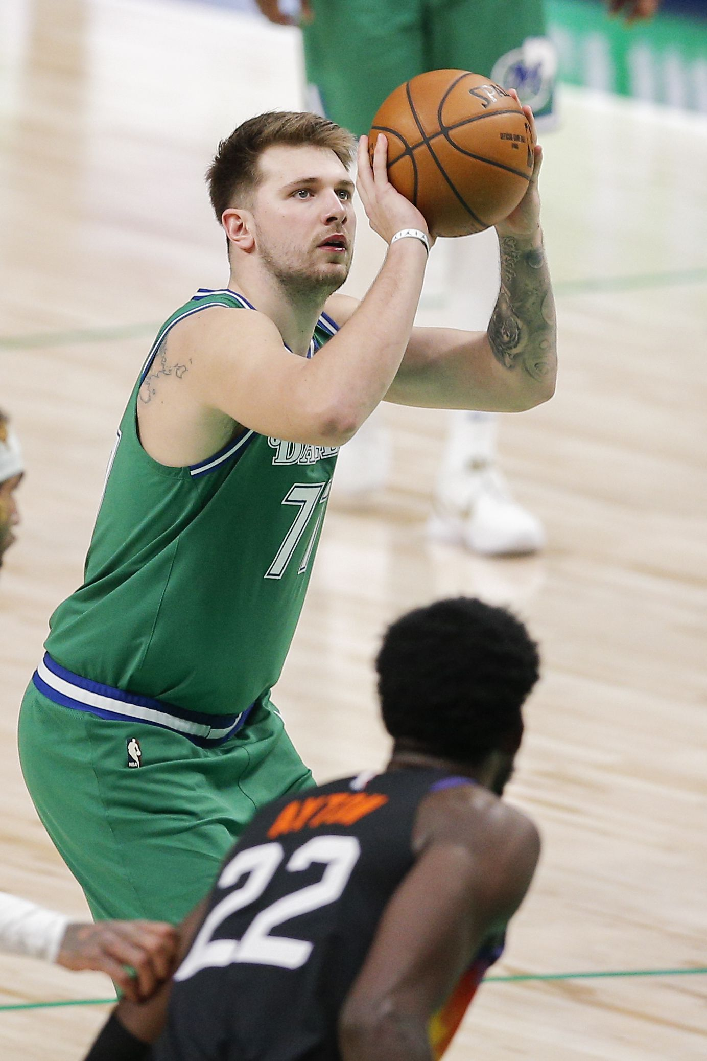 Dallas Mavericks guard Luka Doncic (77) attempts a free throw during the second half of an NBA basketball game in Dallas, Saturday, January 30, 2021. (Brandon Wade/Special Contributor)